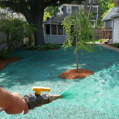 Hydroseed being applied to a lawn.